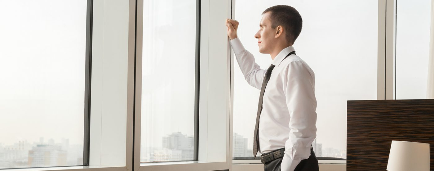 Young traveler businessman looking in window